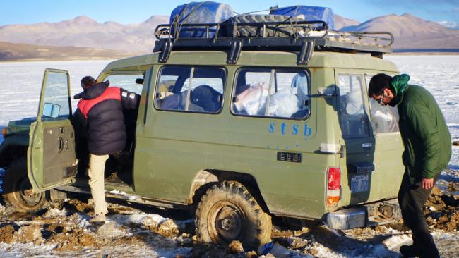 Stuck in the middle: The expedition's support vehicle sparks an emergency, sinking into into the salty mud in a treacherous plain known as Mala Mala or 'bad bad'. Picture: Supplied.