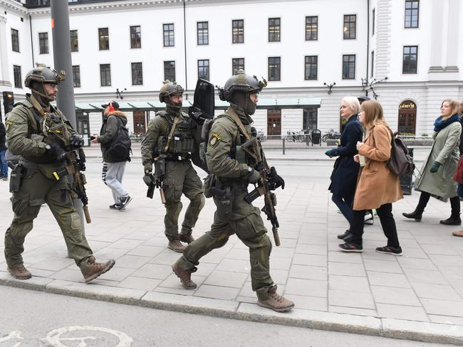 Police officers secure the area outside the Stockholm Central station.