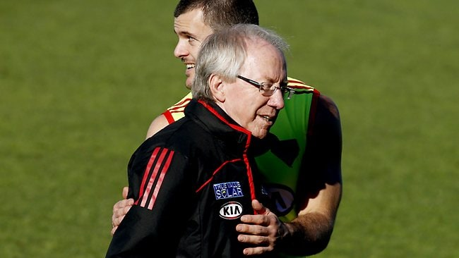 Brent Santon and club doctor Bruce Reid at Essendon training. Picture: Wayne Ludbey
