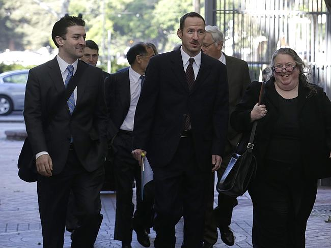 Apple attorney Rachel Krevans, right, walks with others to a federal courthouse in California.