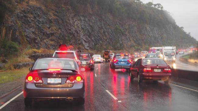 Bad traffic on the Southern Outlet in rain during rush hour in Hobart this morning.
