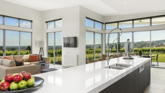 The state-of-the-art kitchen enjoys stunning views.