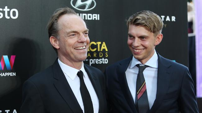 Hugo Weaving and his son Harry Greenwood pictured arriving at the 2015 AACTA Awards.