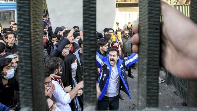 University students attend an anti-government protest inside Tehran University, in Tehran, Iran. Nationwide protests have shaken Iran over past fortnight. Picture: AP