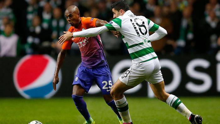 Manchester City's Fernandinho, left, and Celtic's Tom Rogic, battle for the ball during the Champions League, Group C soccer match, Celtic versus Manchester City, at Celtic Park, Glasgow, Scotland, Wednesday Sept. 28, 2016. (Jane Barlow/PA via AP)
