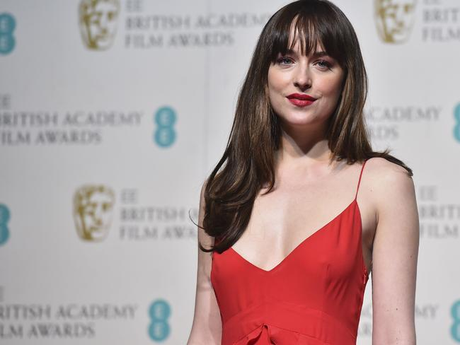 Dakota Johnson poses in the winners area at the BAFTA British Academy Film Awards at the Royal Opera House in London on February 14, 2016. Picture: AFP / Ben Stansall