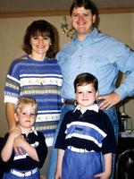 Detective Sergeant Geoff Bowen with wife Jane and sons Matthew and Simon.