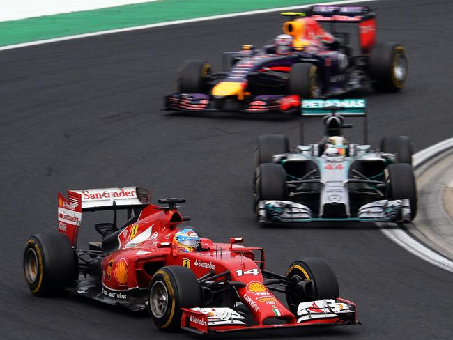 Alonso heads Hamilton and a charging Ricciardo in the closing stages.