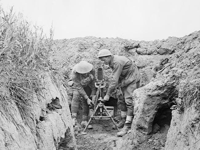In the trenches ... the images reveal the conditions of fighting on the Western Front, 100 years ago. This image shows two men of the 7th Australian Light Trench Mortar Battery operating a light trench mortar established in a machine gun post on the new front line, east of Villers-Bretonneux.