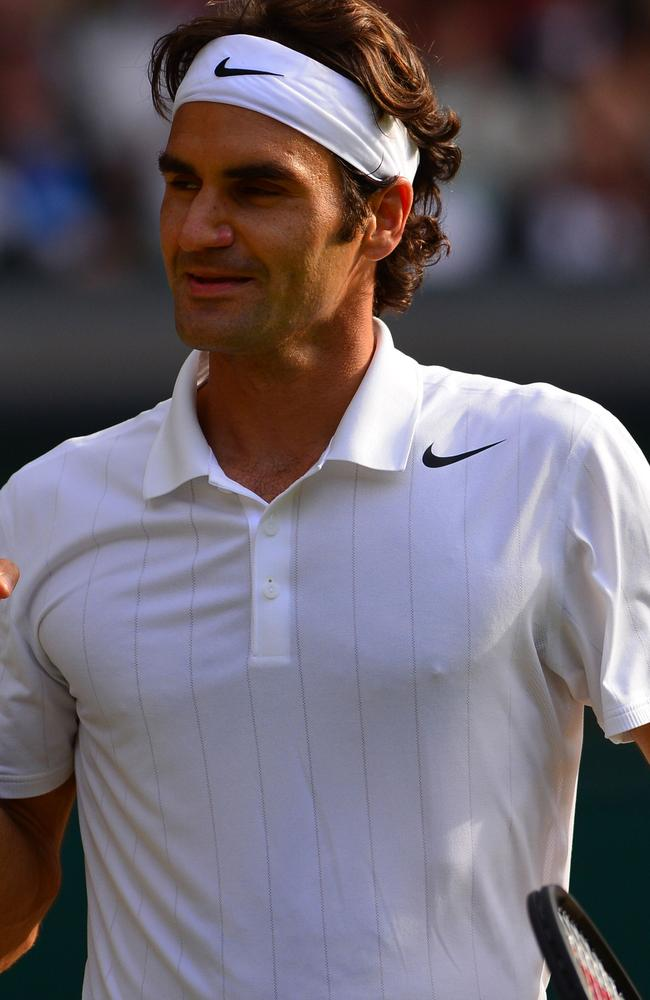 Roger Federer celebrates winning his men's singles semi-final match against Canada's Milos Raonic at Wimbledon.