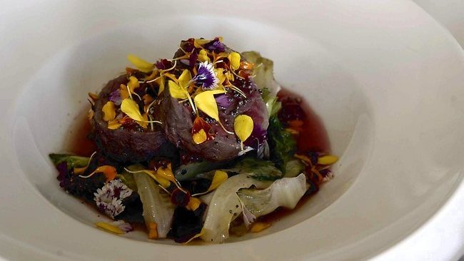 A dish of beef with petal salad at NuNu restaurant at Palm Cove. Picture: Steve Brennan