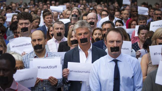 UK journalists in a one-minute silent protest outside New Broadcasting House against the seven-year jail terms given to three Al Jazeera journalists.