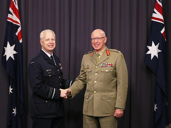 Military men ... outgoing ADF chief General David Hurley congratulates Air Marshal Mark Binskin on his appointment.