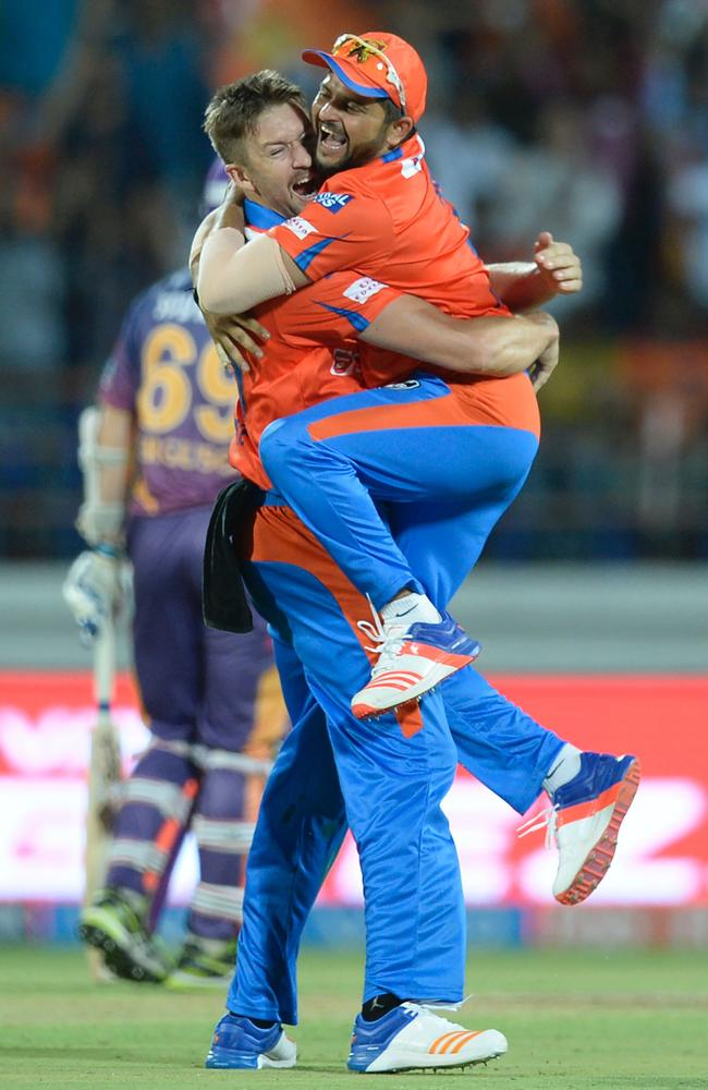 Andrew Tye (L) celebrates with captain Suresh Raina after taking his hat-trick.