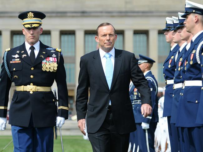 Washington visit ... PM Tony Abbott receives a full honours arrival during his visit to the Pentagon and meeting with the US Secretary of Defence Chuck Hagel. Picture: Jake Nowakowski
