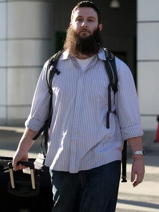 The radical Islamic preacher Musa Cerantonio arrives at Melbourne Airport after being deported from the Philippines.