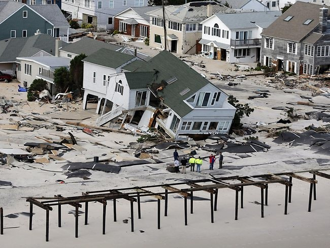 Jersey Shore smashed: people survey destruction to homes and the boardwalk in the wake of superstorm Sandy, in Seaside Heights, N.J.