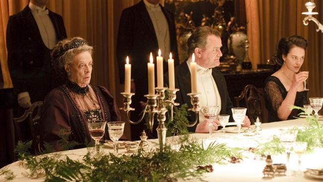 Dinner time scene from TV program 'Downton Abbey with Maggie Smith, Hugh Bonneville and Jessica Brown-Findlay. Picture: Supplied.