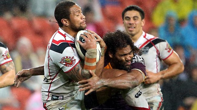 Warriors winger Manu Vatuvei collides with Broncos captain Sam Thaiday. Picture: Darren England