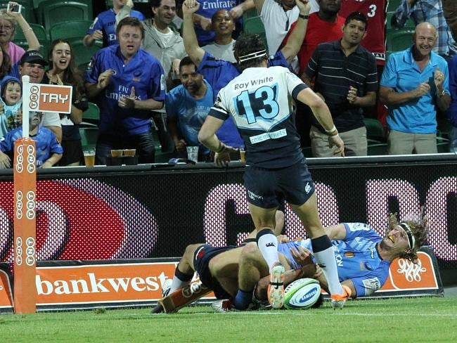 Nick Cummins scores the third try in his hat-trick for the Force against the Waratahs.