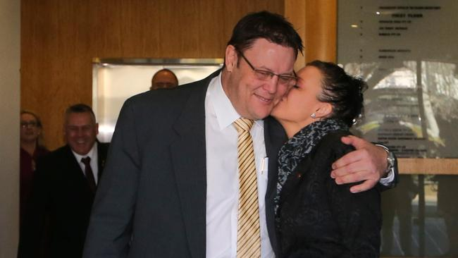 Sealed with a kiss ... Palmer United Party Senators Glenn Lazarus and Jacqui Lambie leave after their morning briefing at their Canberra office in Canberra.