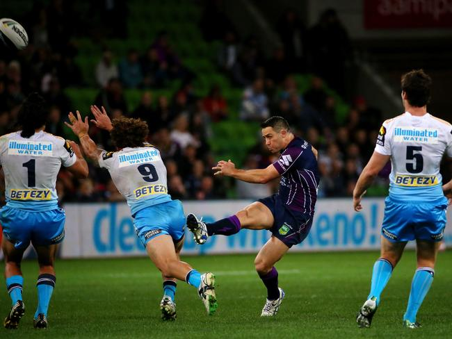 A Titan tries to charge down a kick from Cooper Cronk.