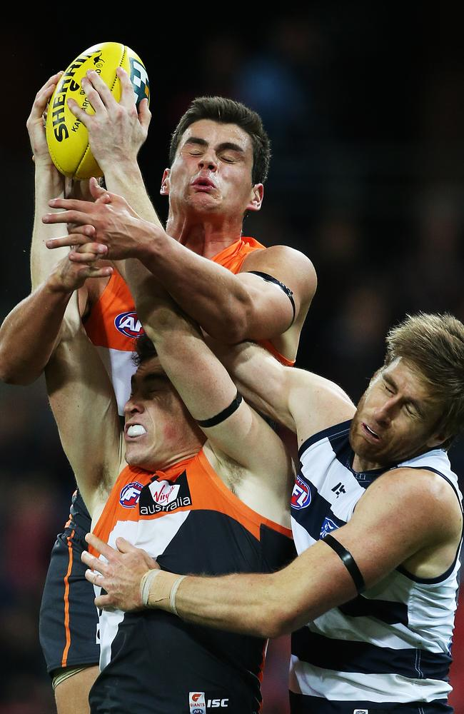 Greater Western Sydney forward Jeremy Cameron marks strongly in front of Tom Boyd. Picture: Phil Hillyard