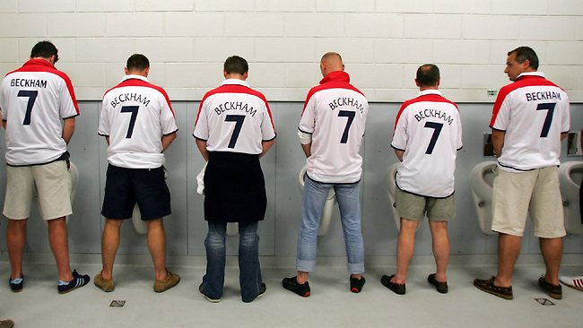 English fans from Belgium wearing David Beckham's No. 7 jersey going to the toilet.
