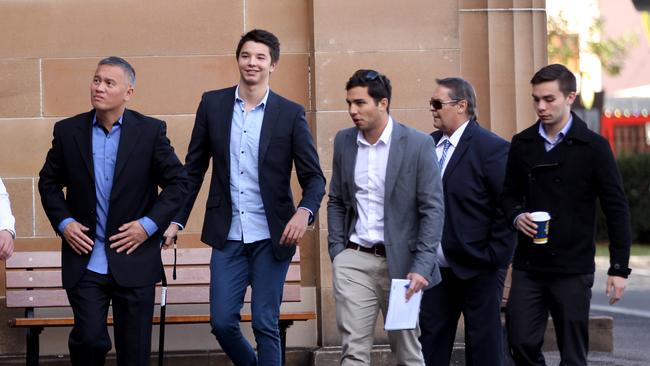 Still smiling: Despite the lifechanging experience, Liam Knight raises a smile as he arrives (with walking stick) at the Darlinghurst court complex.