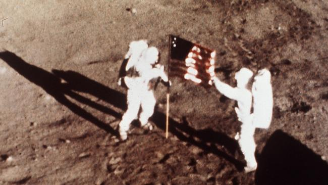 "Apollo 11 astronauts Neil Armstrong and Edwin E. ""Buzz"" Aldrin, the first men to land on the moon, plant the U.S. flag on the lunar surface on July 20, 1969. Picture: AP/NASA."