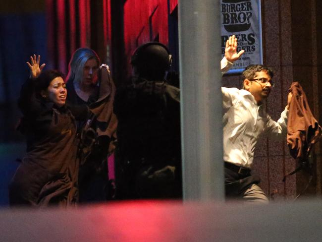 Monis fired at hostages as they ran to safety. Picture: AP Photo/Rob Griffith