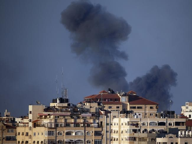 Smoke billows from a building hit by an Israeli air strike in Gaza City, yesterday. Picture: AFP Photo/Thomas Coex