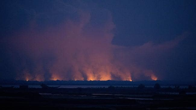Smoke and flames in Myanmar are seen from the Bangladeshi side of the border near Cox's Bazar's Teknaf area, Sunday, Sept. 3, 2017. Picture: Bernat Armangue