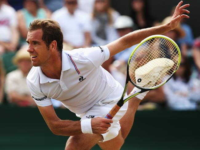 Gasquet with his stylish follow-through after a big serve.