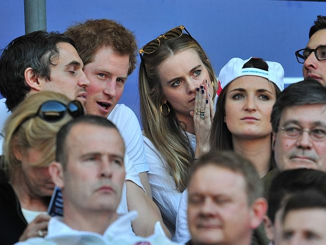 Triple Crown ... Prince Harry and British socialite Cressida Bonas watch the Six Nations
