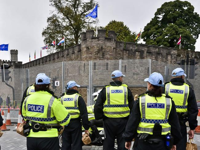A NATO flag and flags of many nations fly from the ramparts of Cardiff Castle as a heavy police presence secures the area ahead of the upcoming NATO summit in Newport, Wales. Source: AP