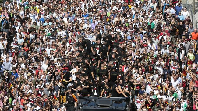 The German team celebrate on an open top vehicle on the way to the Brandenburg Gate in Berlin.