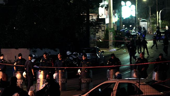 Police secure the area around the Golden Dawn party office in northern Athens. Picture: AFP
