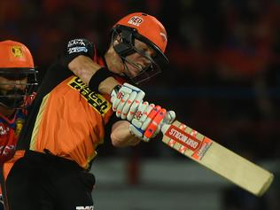 Sunrisers Hyderabad captain David Warner (R) watched by Gujarat Lions wicketkeeper Dinesh Karthik plays a shot during the 2016 Indian Premier League(IPL) Twenty20 cricket match between Gujarat Lions and Sunrisers Hyderabad at the Saurashtra Cricket Association Stadium in Rajkot on April 21, 2016. ----IMAGE RESTRICTED TO EDITORIAL USE - STRICTLY NO COMMERCIAL USE----- / AFP PHOTO / INDRANIL MUKHERJEE / ----IMAGE RESTRICTED TO EDITORIAL USE - STRICTLY NO COMMERCIAL USE----- / GETTYOUT