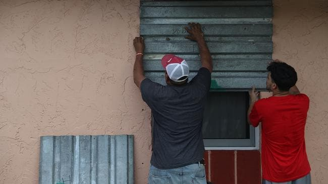 Residents are boarding up their windows right across southern Florida. Picture: Joe Raedle