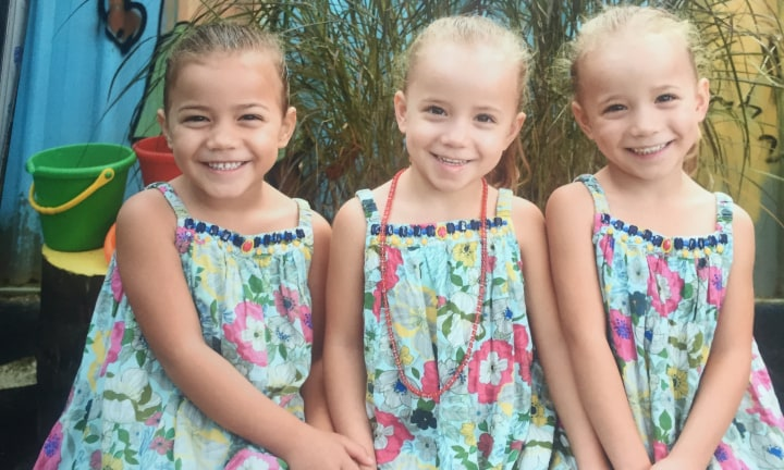 The triplets in a recent preschool photo.