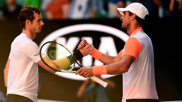 Mischa Zverev of Germany (right) is congratulated by Andy Murray of Great Britain (left) after Zverev defeated Murray in round four on day seven, at the Australian Open in Melbourne, Australia, Sunday Jan. 22, 2017. (AAP Image/Dean Lewins) NO ARCHIVING, EDITORIAL USE ONLY
