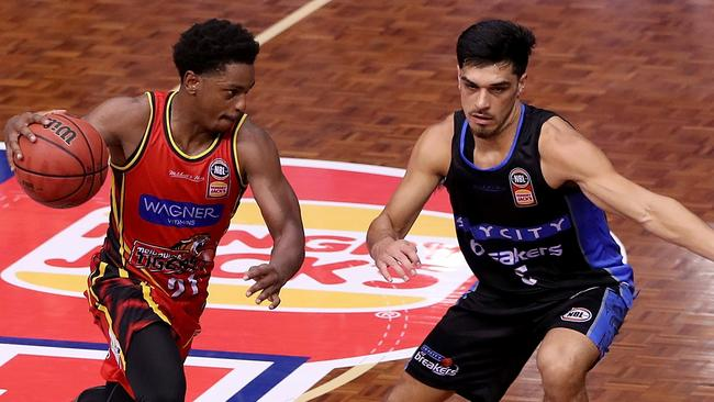 Casper Ware drives by Breakers guard Shea Ill. Pic: AAP