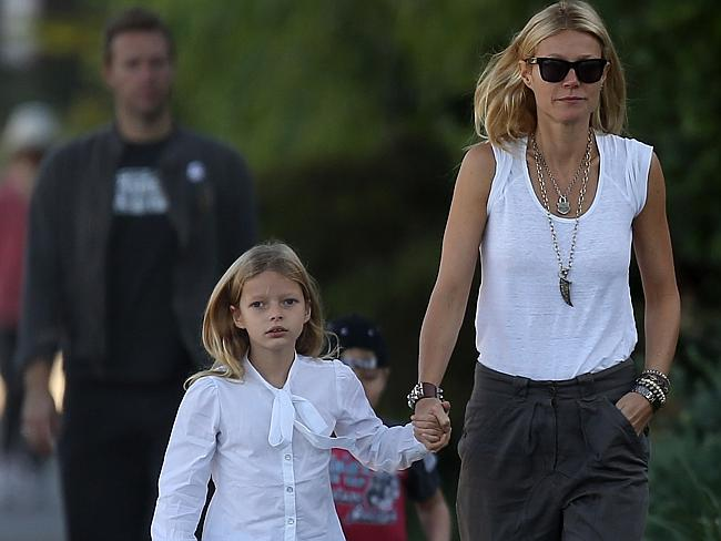 Gwyneth Paltrow and Chris Martin take Apple and Moses for a walk. SPLASH NEWS