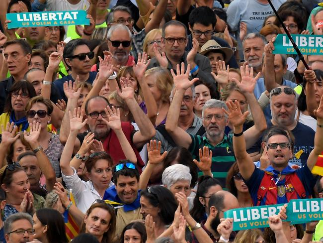 Protesters raise their hands during a demonstration in Barcelona. Picture: AFP