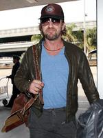 <p>A ruggedly handsome Gerard Butler rocks up at LAX. Picture: Snappermedia</p>