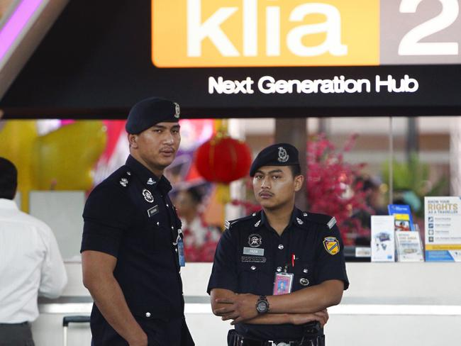 Police officers patrol inside the Kuala Lumpur International Airport in Sepang, Malaysia where Kim Jong-un's half-brother was killed. Picture: AP Photo.