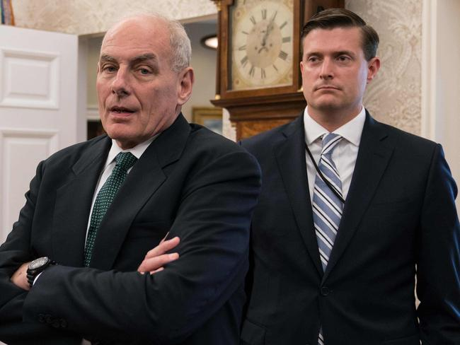 White House chief of staff John Kelly (C) and White House staff secretary Rob Porter. Picture: AFP