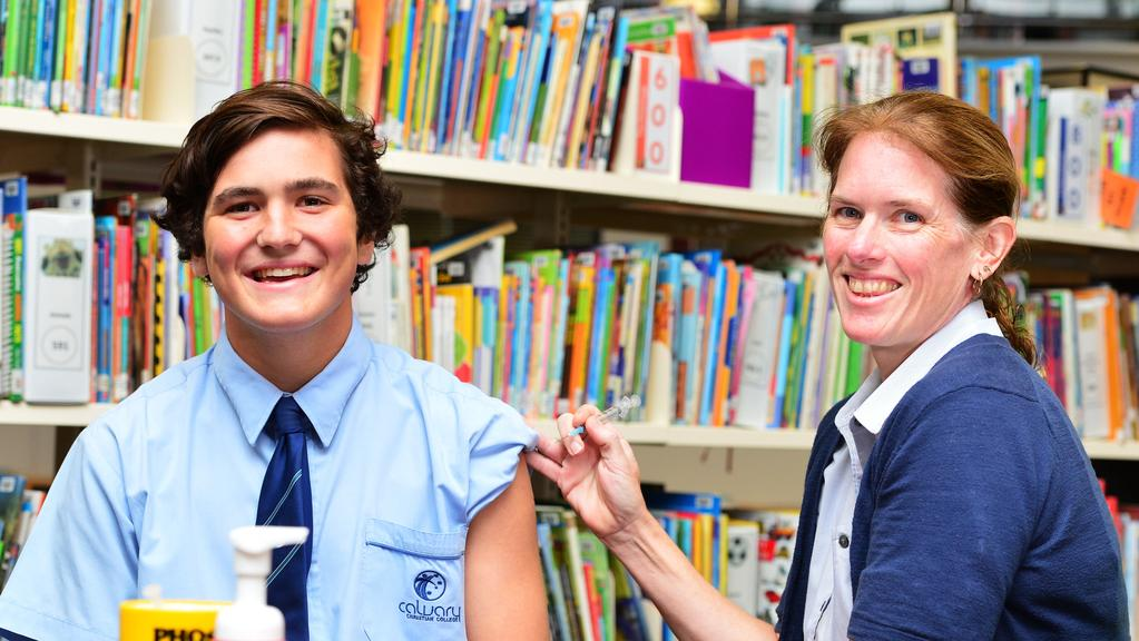 Grade 10 Calvary Christian College student Zac Speet, 16, gets a Meningococcal vaccination from Nurse Julie Boxsell.