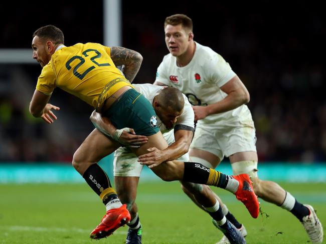 Quade Cooper is crunched by Jonathan Joseph during the Old Mutual Wealth Series last year.